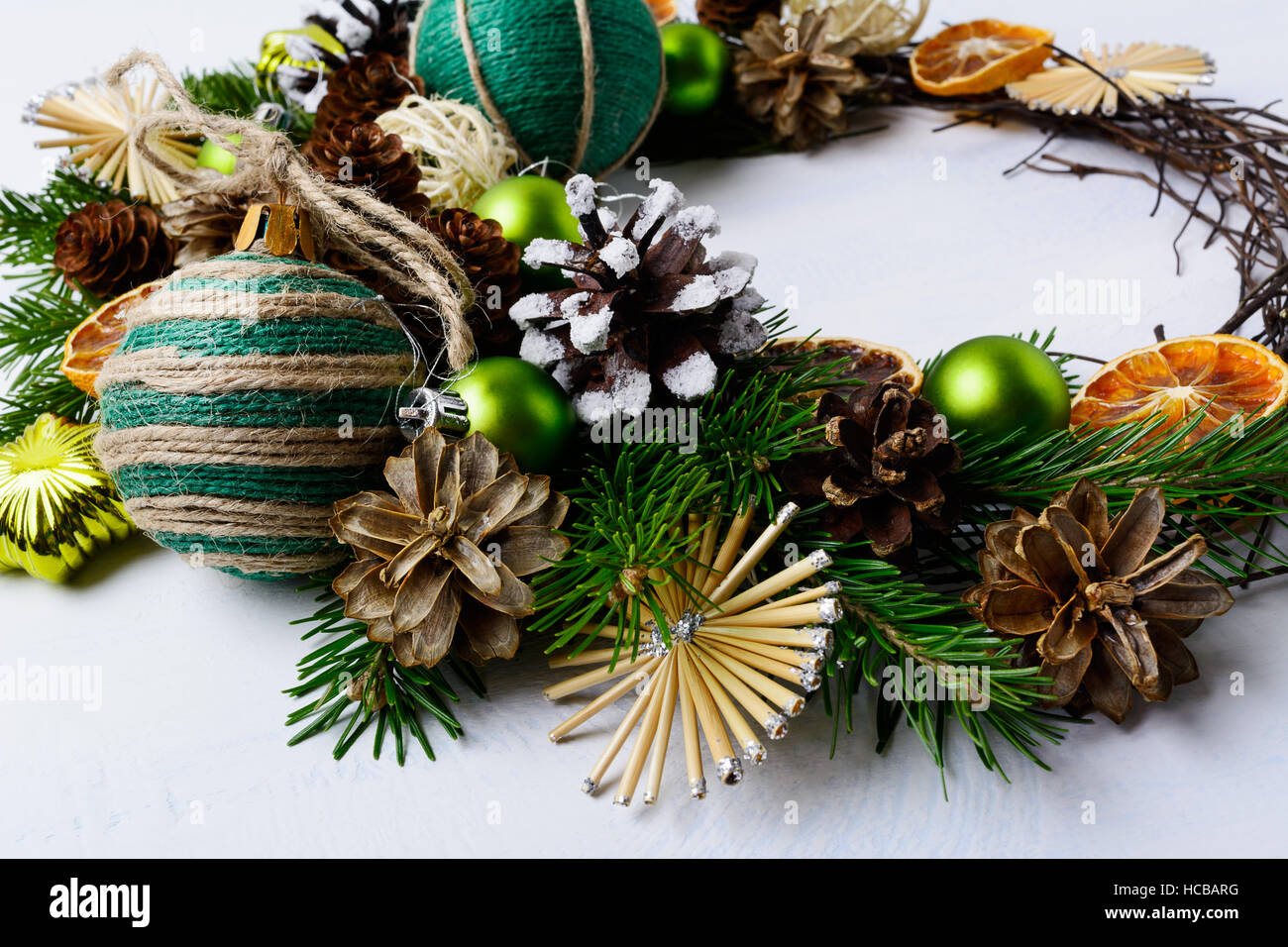 Christmas Wreath With Straw Stars Dried Oranges And Rustic Ornament Background Handmade Balls Decoration Fir Branches
