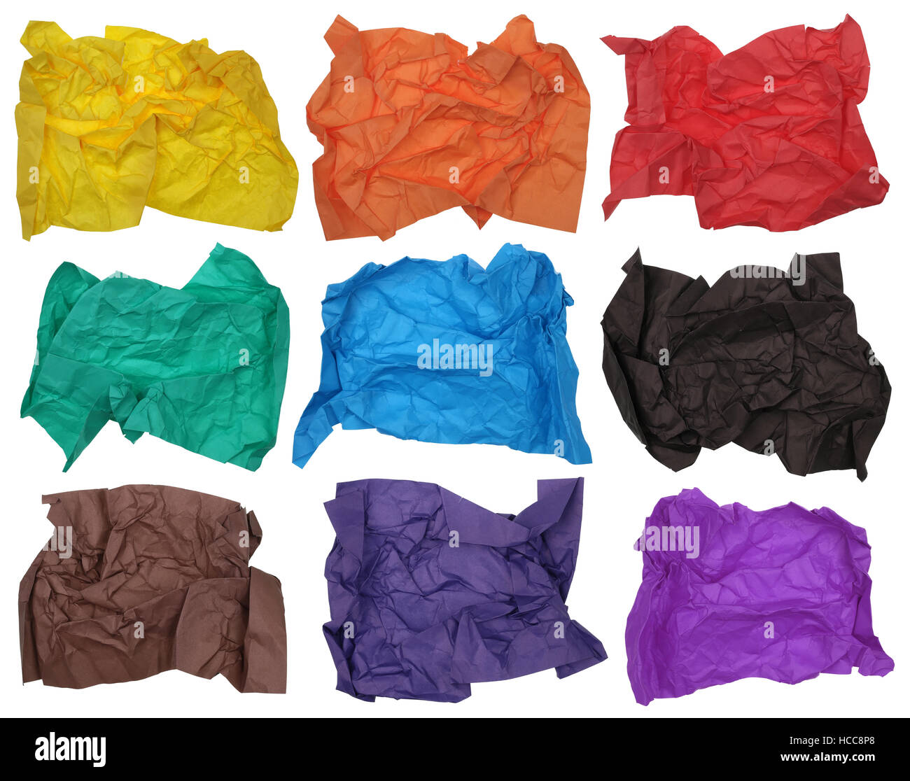 Nine crumpled  sheets of cheap friable color paper for origami or children's art collages. Isolated on white - Stock Image