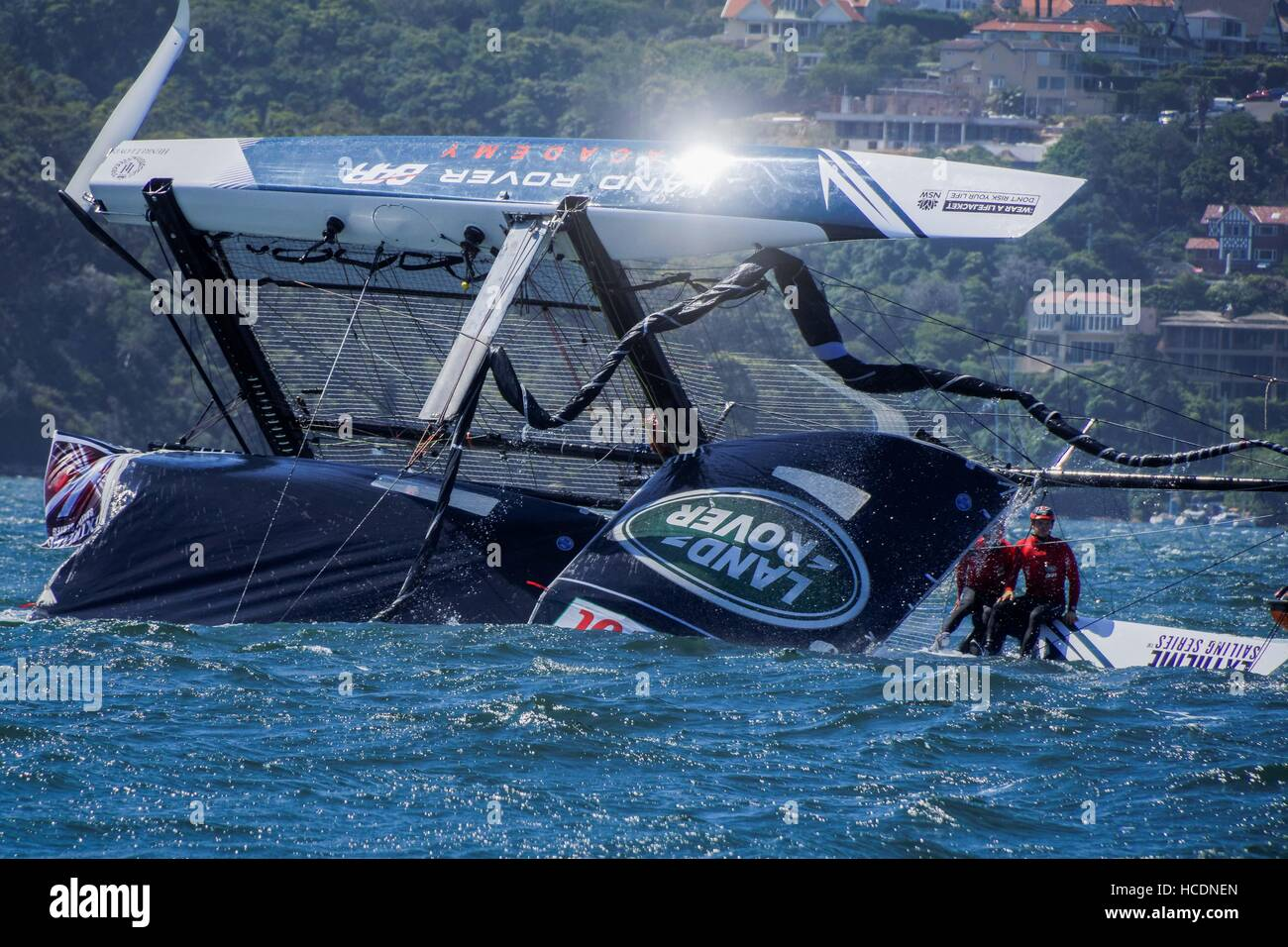 Sydney, Australia. 08th Dec, 2016. Land Rover BAR Academy (GBR), skippered by Neil Hunter (GBR) is righted slowly - Stock Image