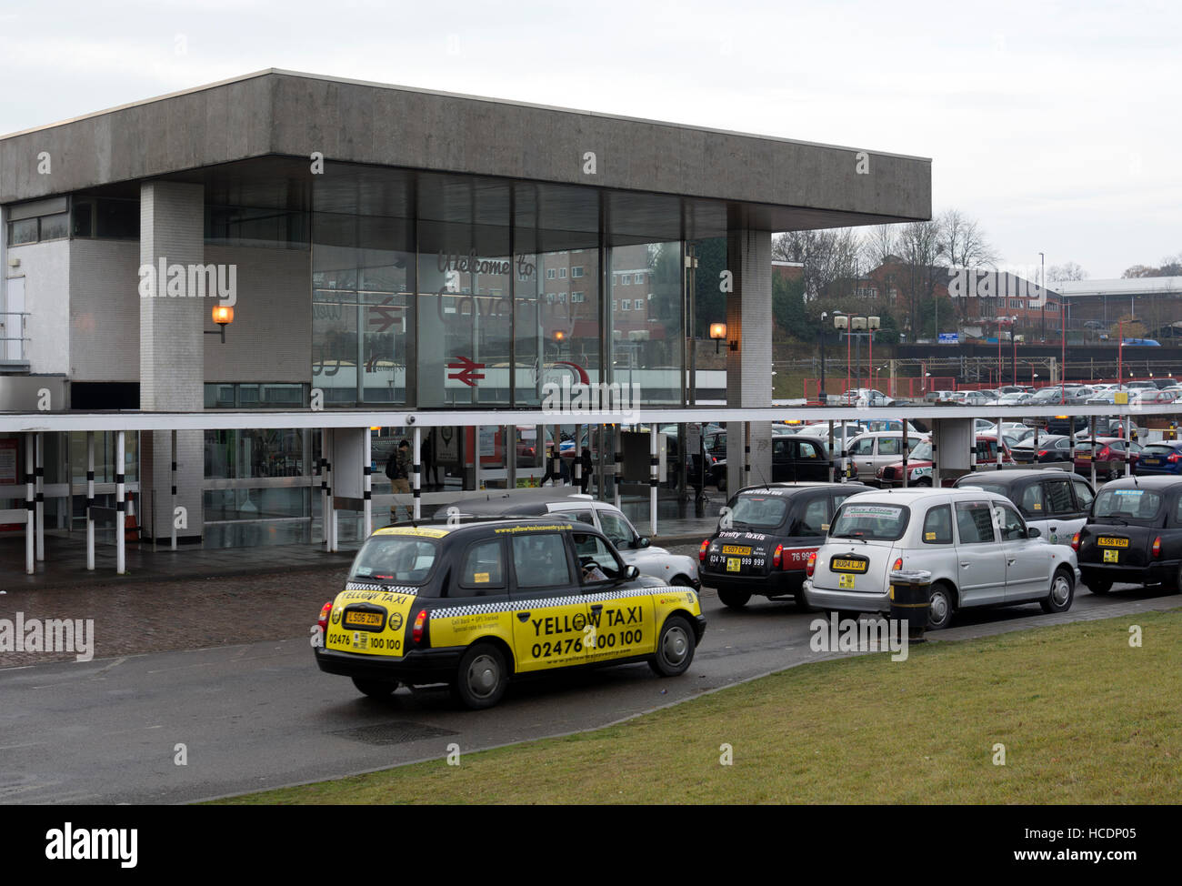 Taxis outside Coventry railway station, West Midlands, England, UK - Stock Image