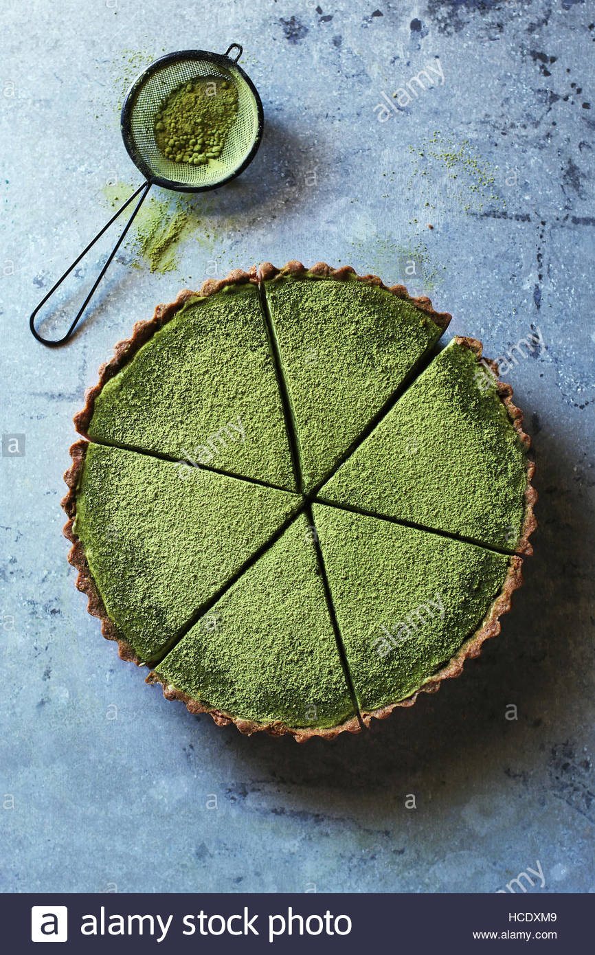Sliced matcha tart with cream cheese filling.Top view - Stock Image