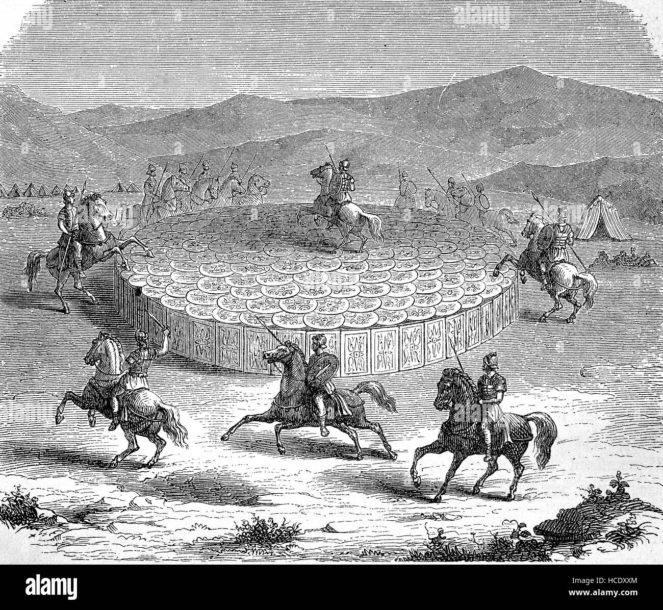 In Ancient Roman warfare, the testudo or tortoise formation was a formation used commonly by the Roman Legions during - Stock Image