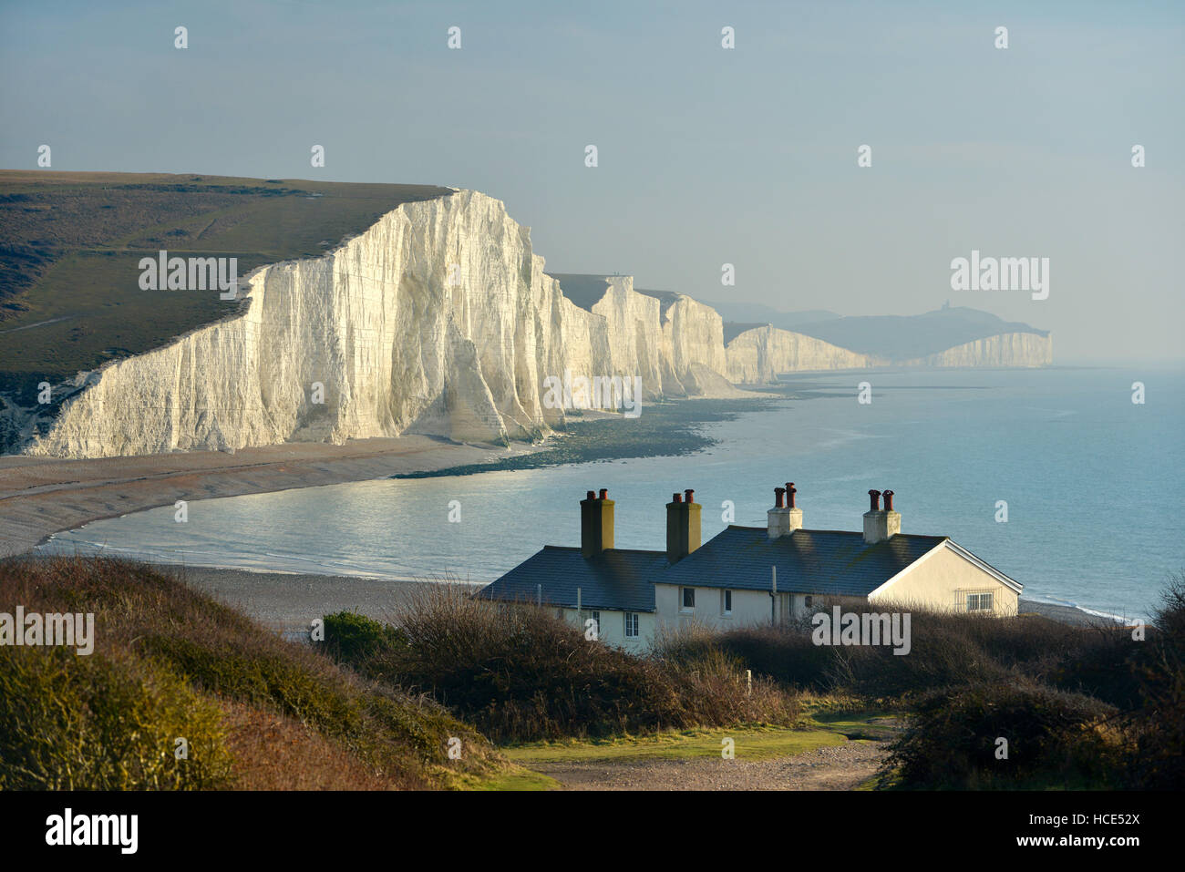 Seven Sisters chalk cliffs. The iconic Sussex coastal view of the South Downs National Park with a low sun Stock Photo