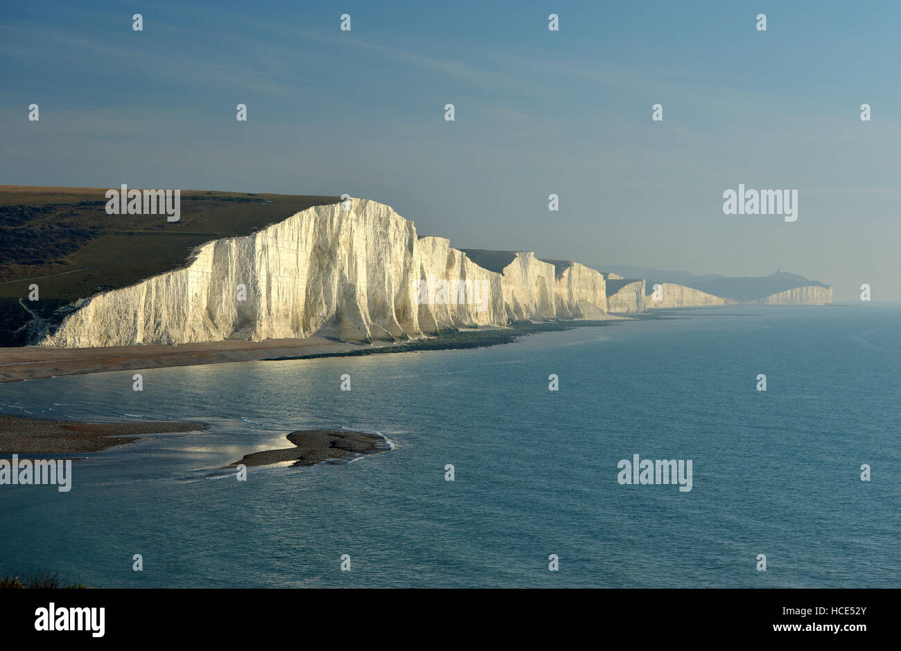 Seven Sisters chalk cliffs. The iconic Sussex coastal view of the South Downs National Park with a low sun - Stock Image
