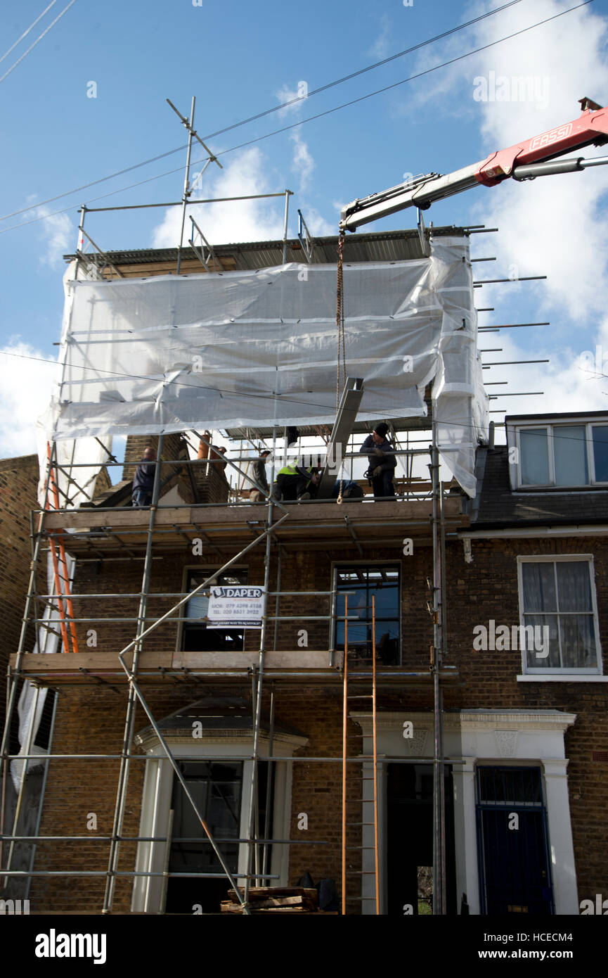 Hackney. Gentrification. Doing up a house - putting on a new roof. - Stock Image