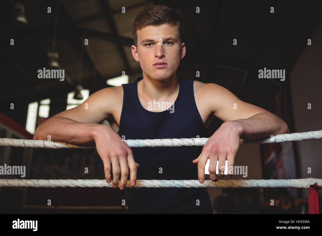 Boxer standing in boxing ring - Stock Image