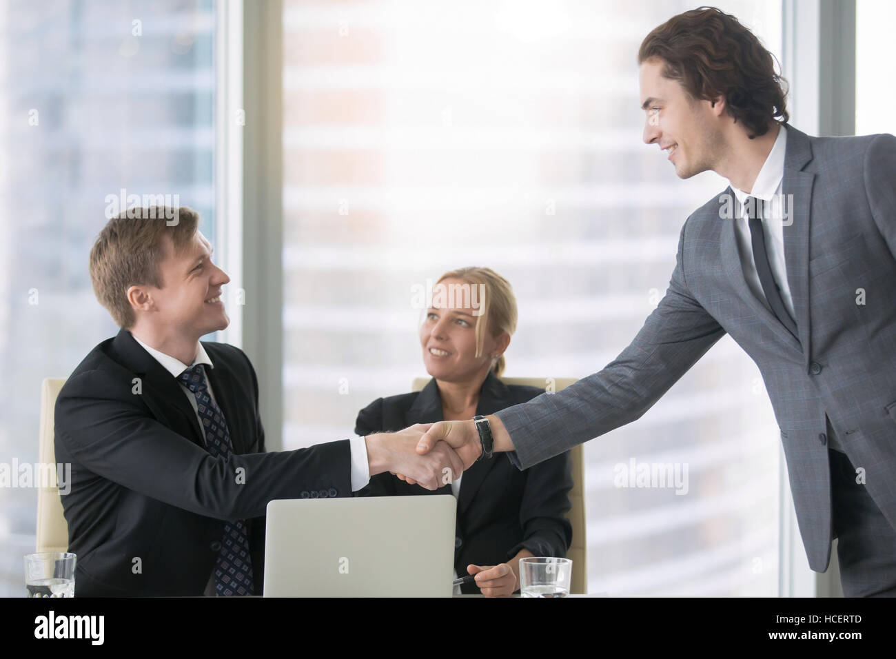 Business people greeting each other stock photo 128174493 alamy business people greeting each other m4hsunfo
