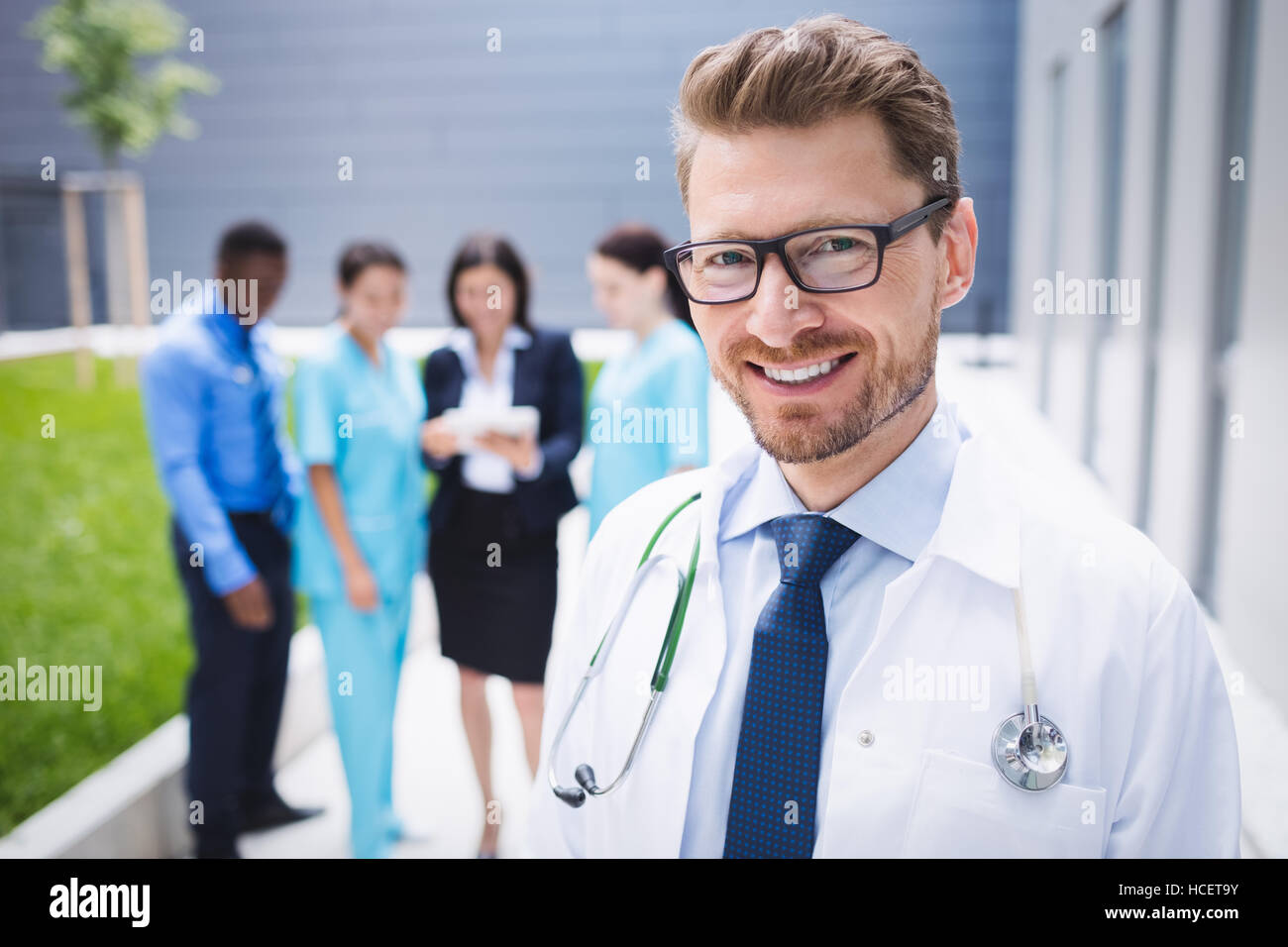 Doctor standing in hospital premises Stock Photo