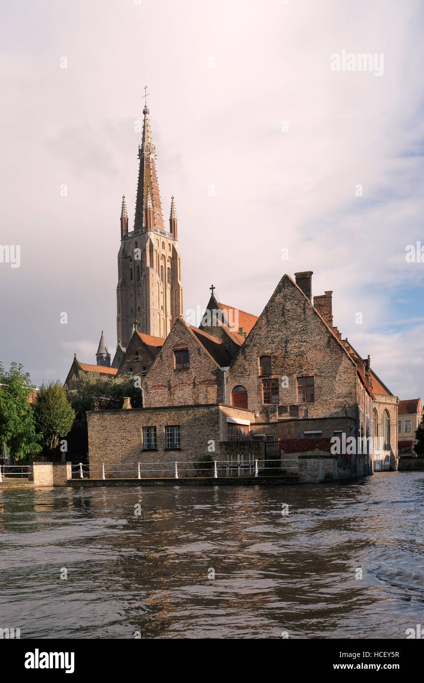 Sint-Janshospitaal, Saint John's Hospital, Bruges. Begun in the 12th century, seen from the canal, with the - Stock Image