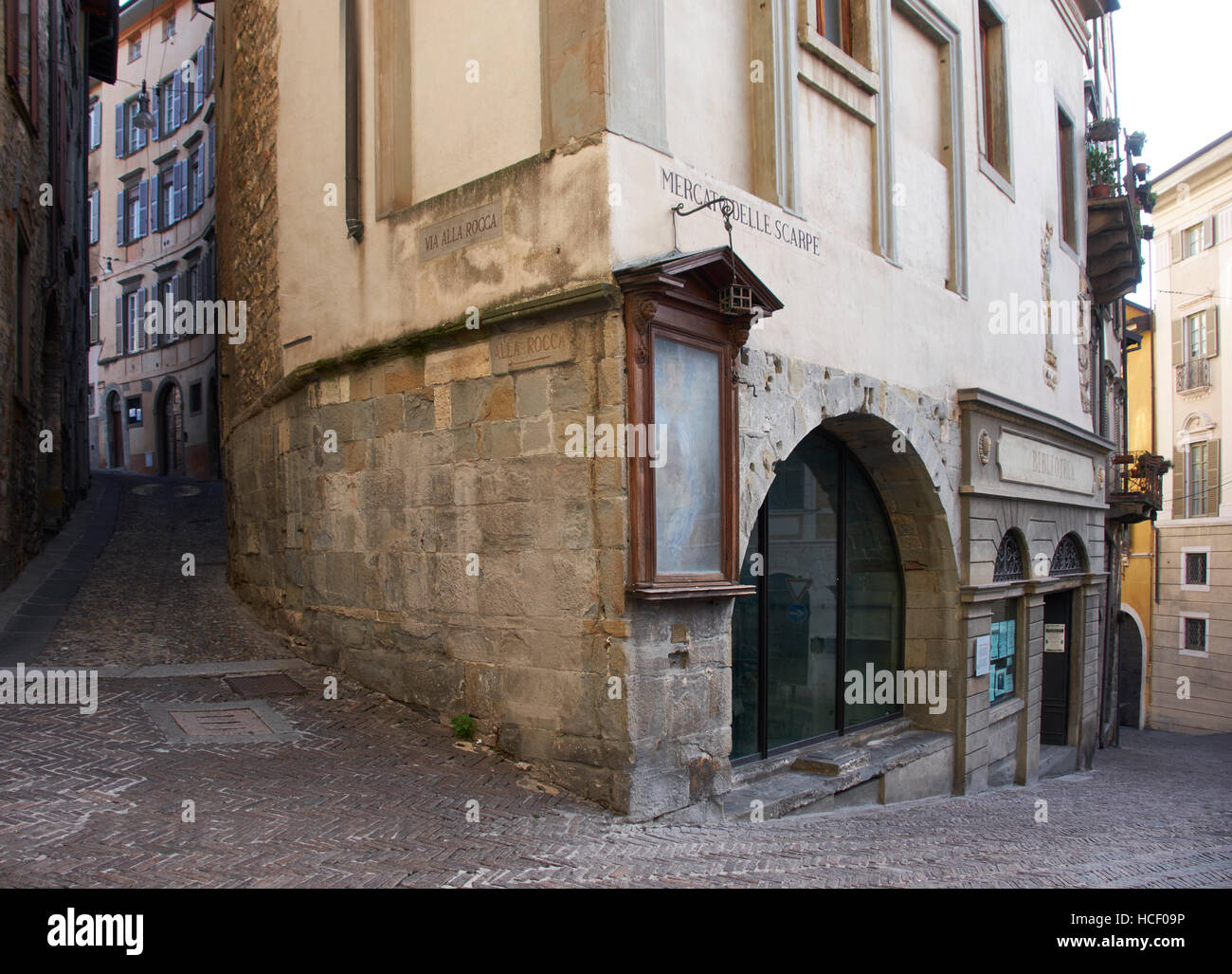 Bergamo, Italy. Narrow twisting streets on the hilly site of the ancient city: Via alla Rocca and the Mercato delle - Stock Image