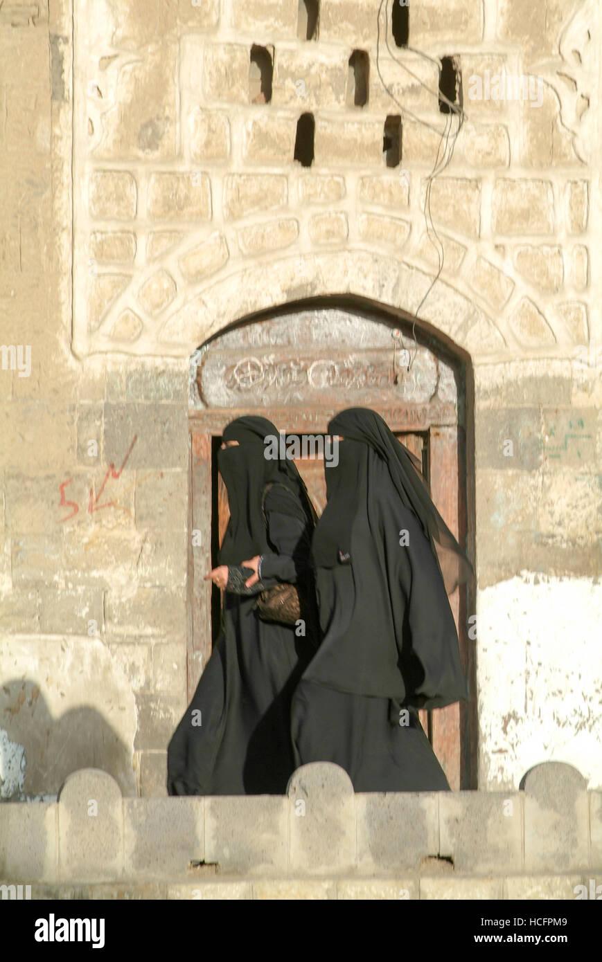 Sana, Yemen - 19 January 2008: women wearing the burqa and walking on the street of old Sana, Yemen - Stock Image