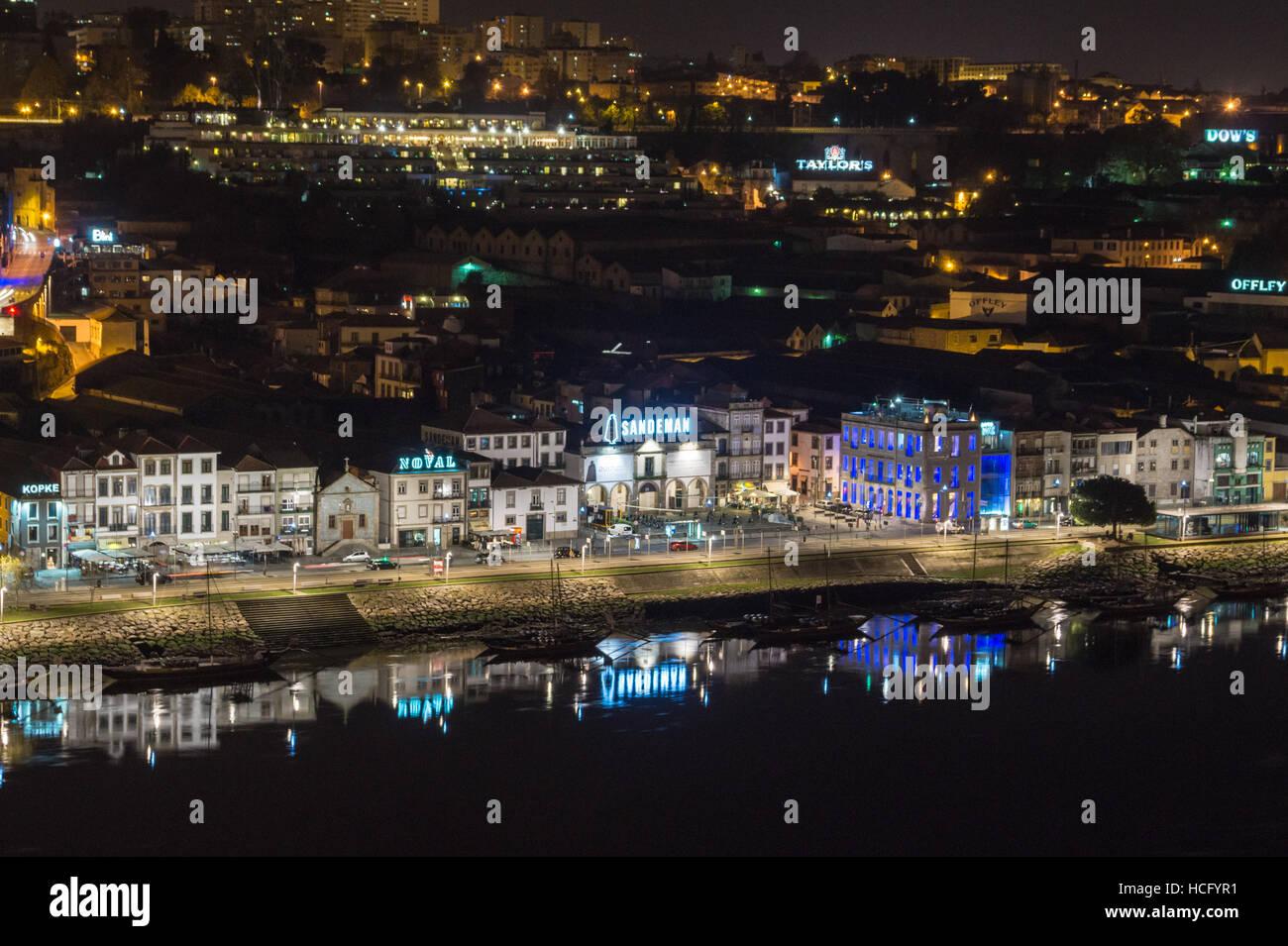 Port lodges, Vila Nova de Gaia, River Douro, Porto, Portugal, at dusk seen from the Ribeira Stock Photo