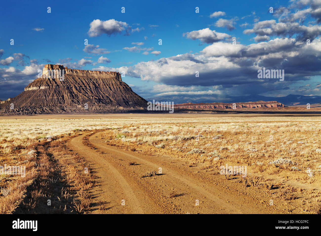 Factory Butte, isolated flat-topped sandstone mountain in Utah desert, USA - Stock Image
