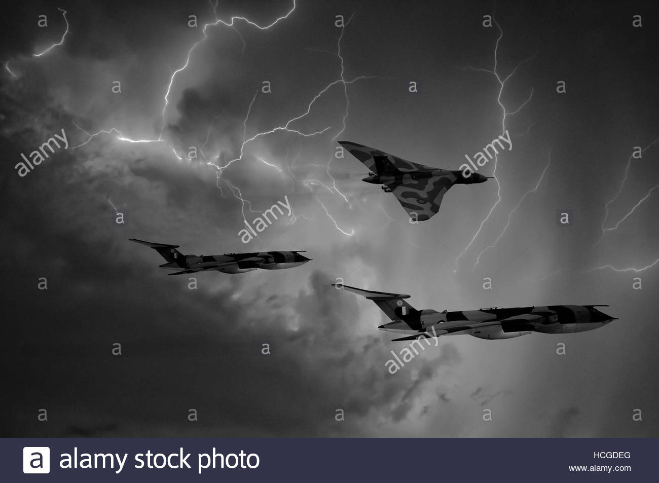 RAF Avro Vulcan bomber XM607 receives fuel from a Handley Page Victor tanker, during air to air refueling operations - Stock Image