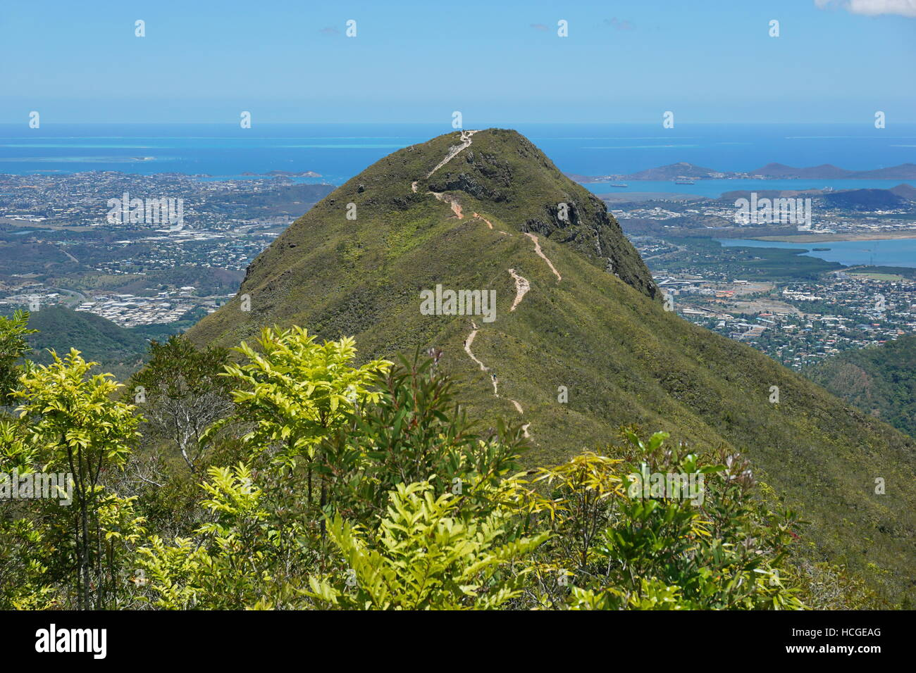 The peak Malaoui with the Pacific ocean and the city of Noumea in background, New Caledonia, south Pacific - Stock Image