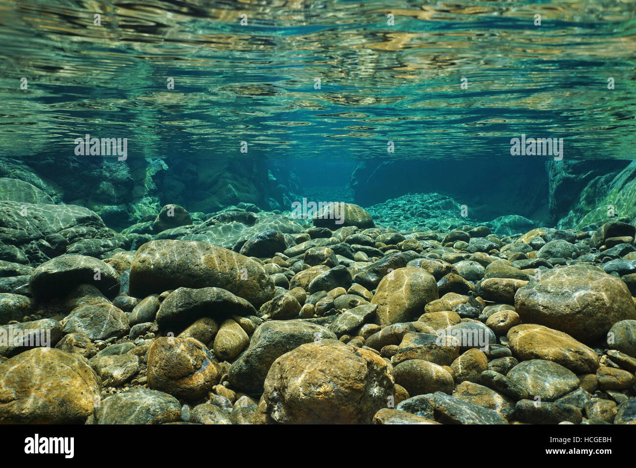 Rocks underwater on riverbed with clear freshwater, Dumbea river, Grande Terre, New Caledonia - Stock Image