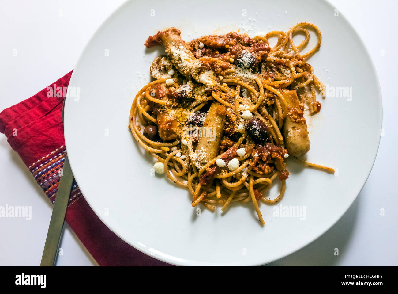 Spaghetti with sausage and olives Stock Photo