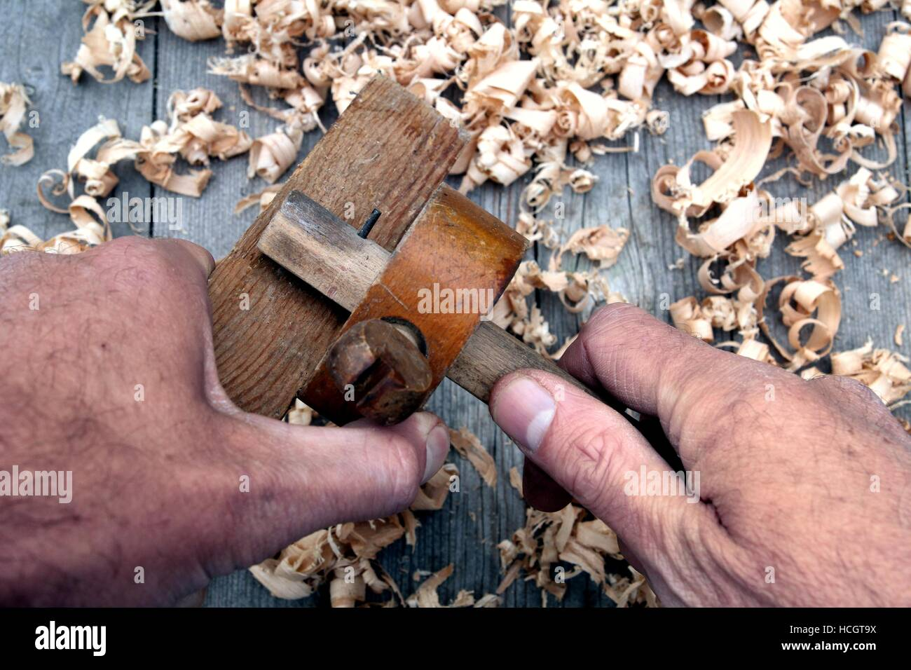 Traditional woodworker using antique wooden mortise gauge - Stock Image
