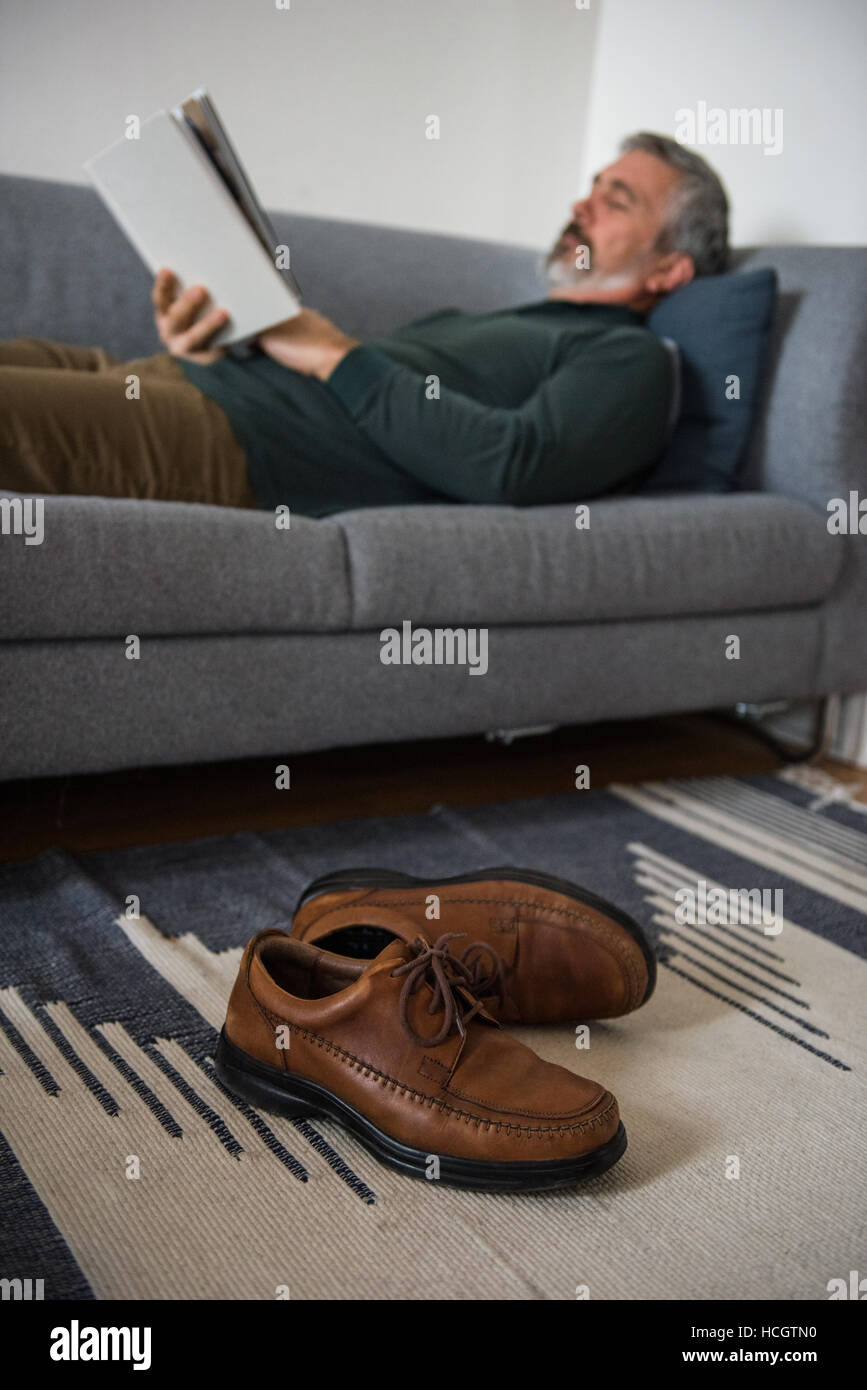 home, house, household, homey, apartment, domicile, abode, living room, casual clothing, sofa, sitti - Stock Image