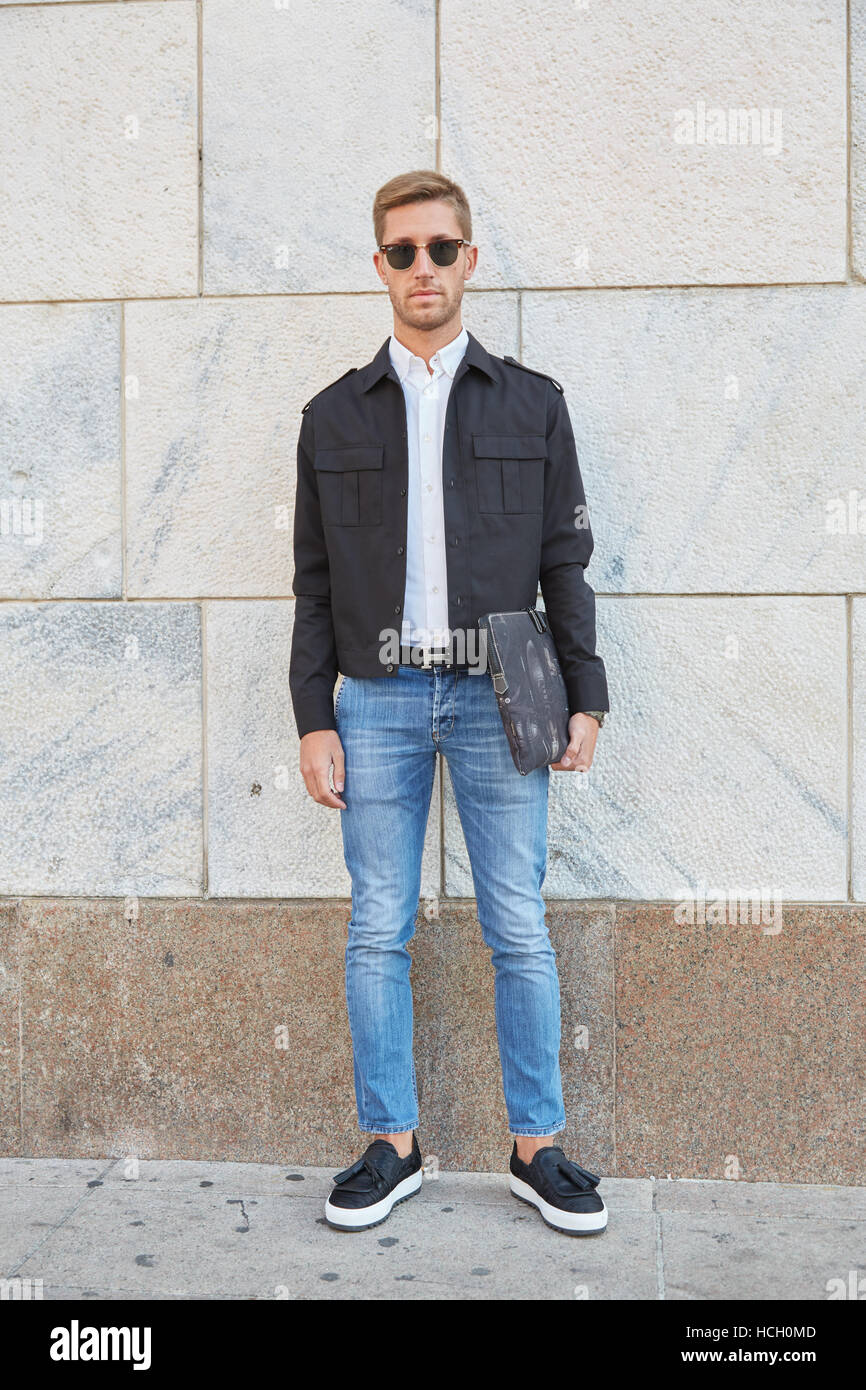 Man with blue jeans and black jacket before Cristiano Burani fashion show, Milan Fashion Week street style on September - Stock Image
