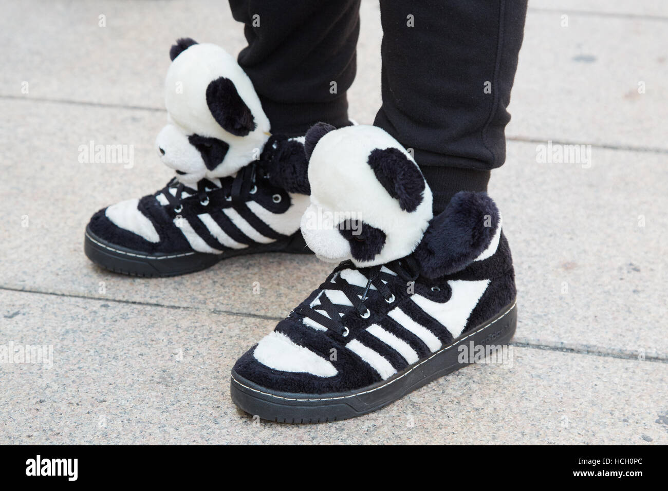 magasin en ligne ad78f 53a37 Man with panda bear puppet Adidas shoes before Cristiano ...