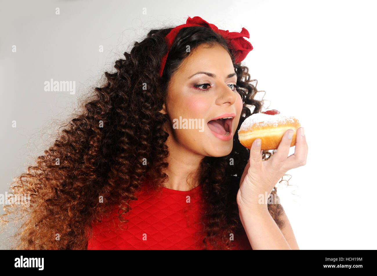 woman with Hanukkah  donuts - Stock Image