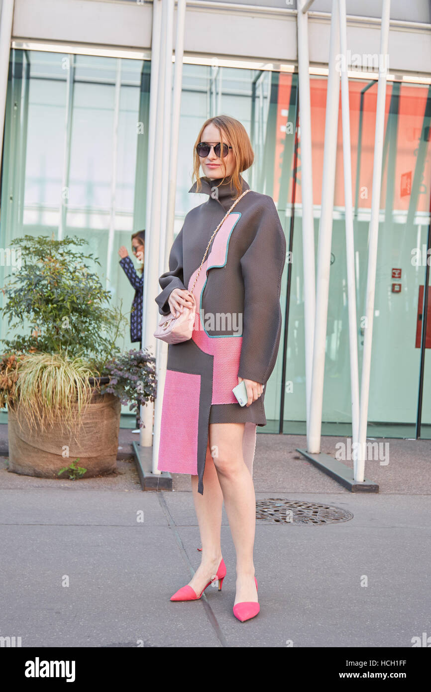 Woman with gray and pink coat before Jil Sander fashion show, Milan Fashion Week street style on September 24, 2016 - Stock Image
