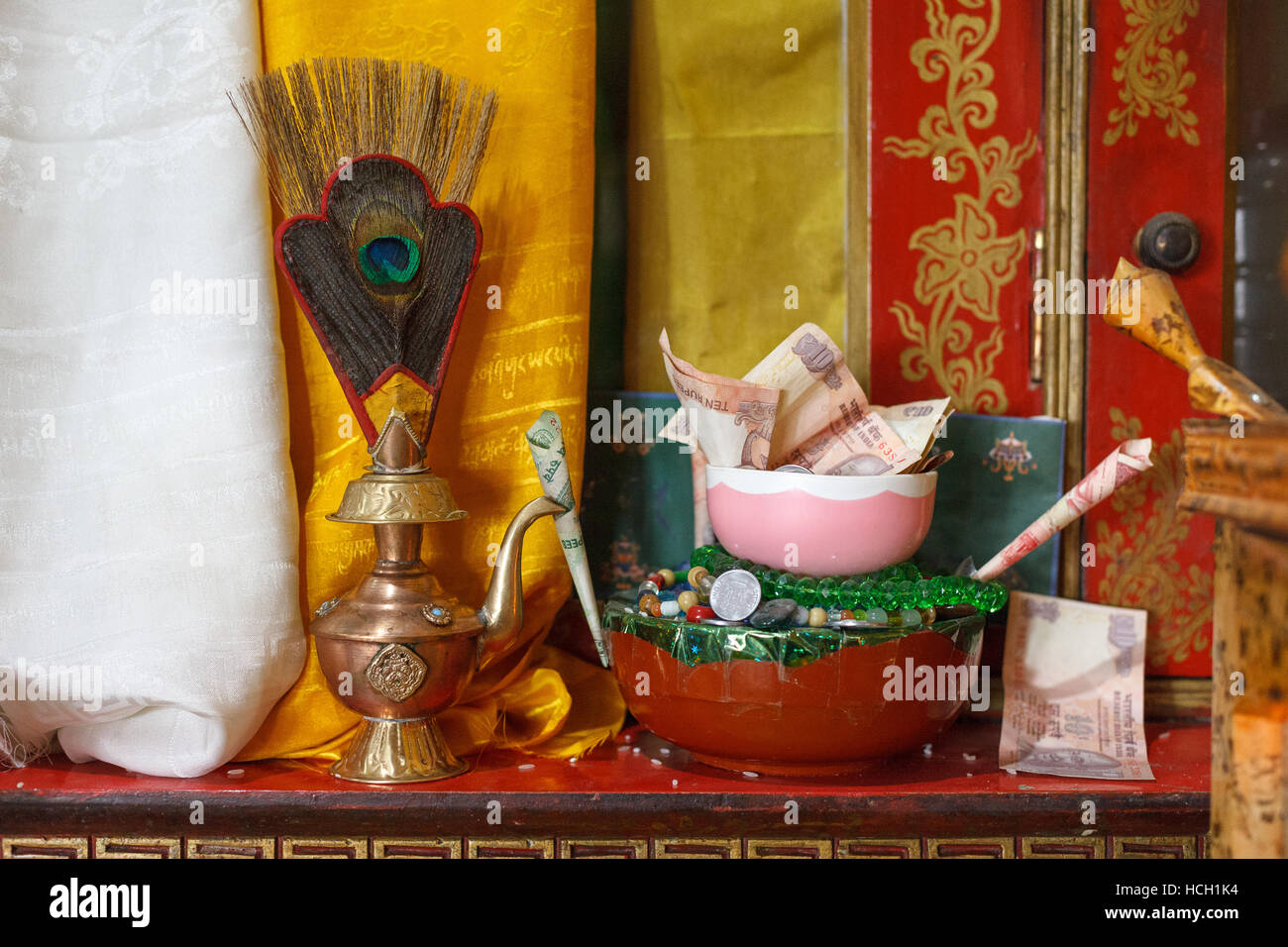 Altar offerings at the tibetan buddhism temple, India - Stock Image
