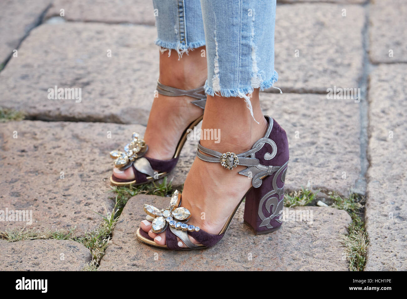Woman with purple high heel shoes with gems decoration before Salvatore Ferragamo fashion show, Milan Fashion Week - Stock Image