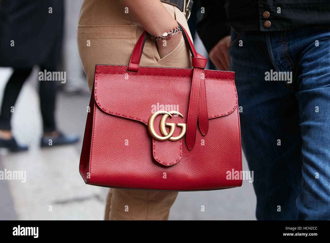 753fe32b Woman with Gucci red leather bag before Max Mara fashion show, Milan  Fashion Week street style on September 22, 2016 in Milan.