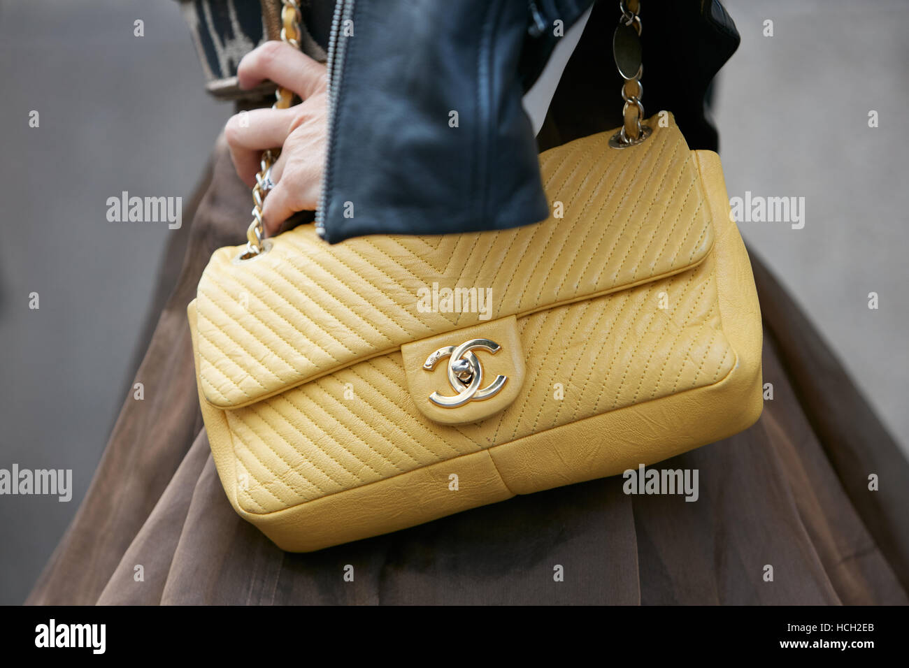 5178a55bba14 Woman with yellow Chanel bag before Max Mara fashion show