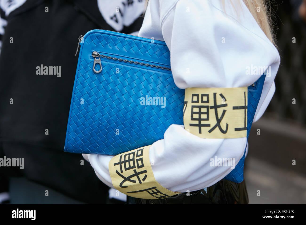 Woman with Bottega Veneta blue bag before Max Mara fashion show, Milan  Fashion Week street style on September 22, 2016 in Milan. 3899bfdac4