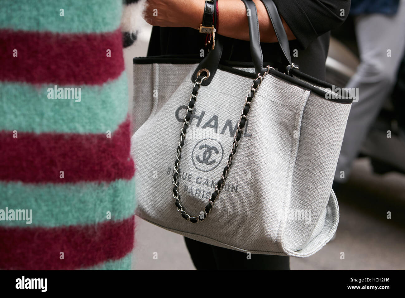 5dfe400f2574 Woman with Chanel canvas bag before Max Mara fashion show