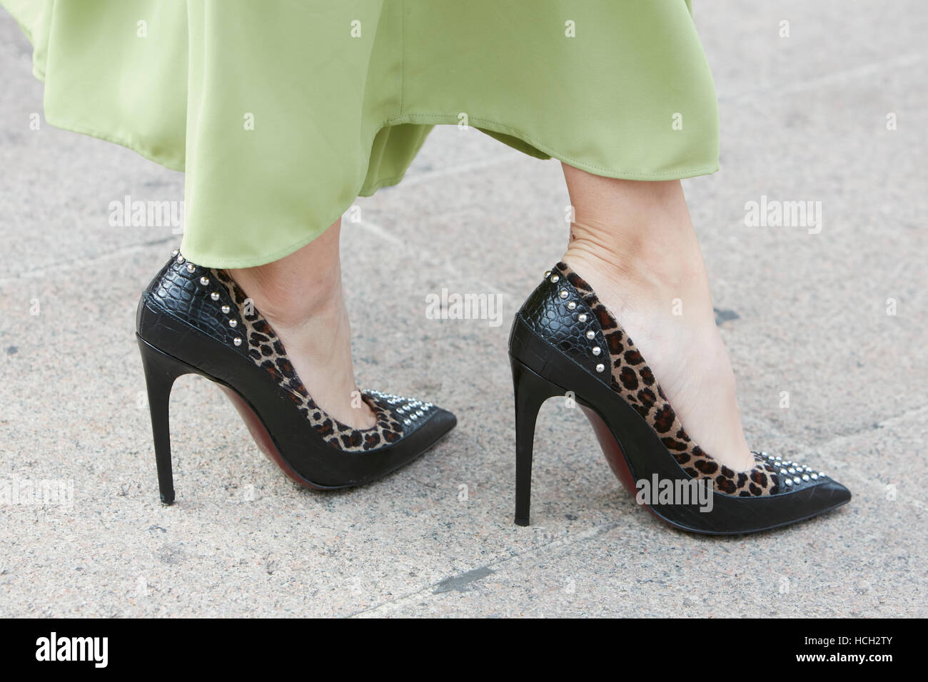 Woman with high heel black leather shoes and studs before Cristiano Burani fashion show, Milan Fashion Week street - Stock Image