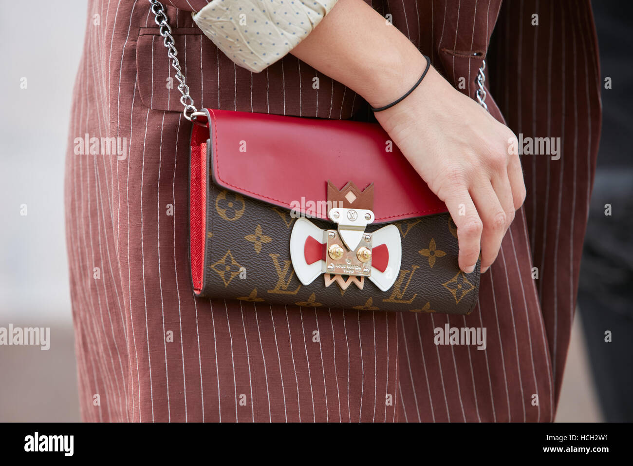 0196c10c5 Woman with Louis Vuitton bag in red leather before Cristiano Burani fashion  show, Milan Fashion