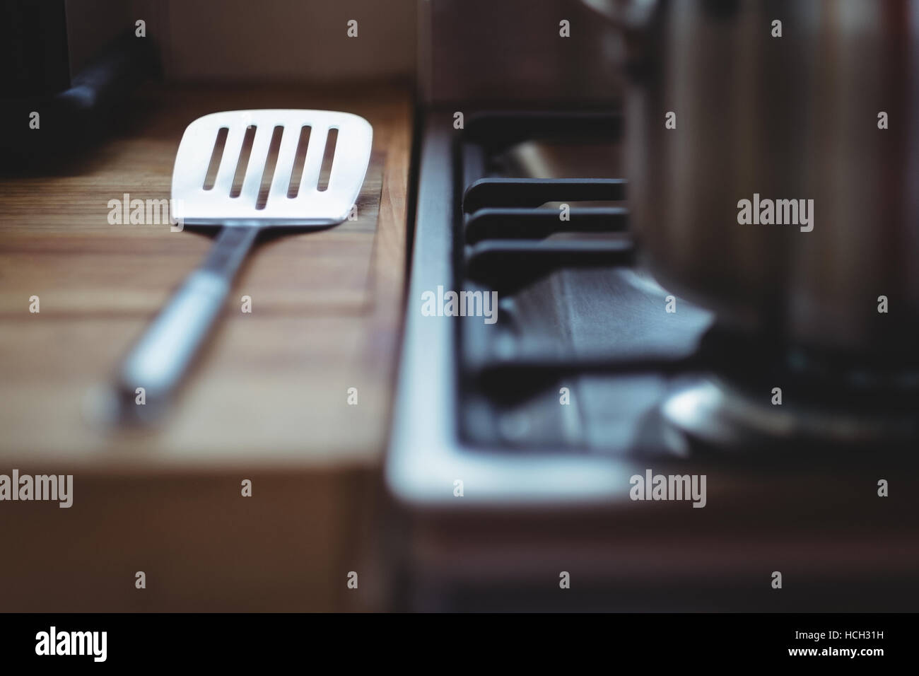 Spatula on wooden table - Stock Image