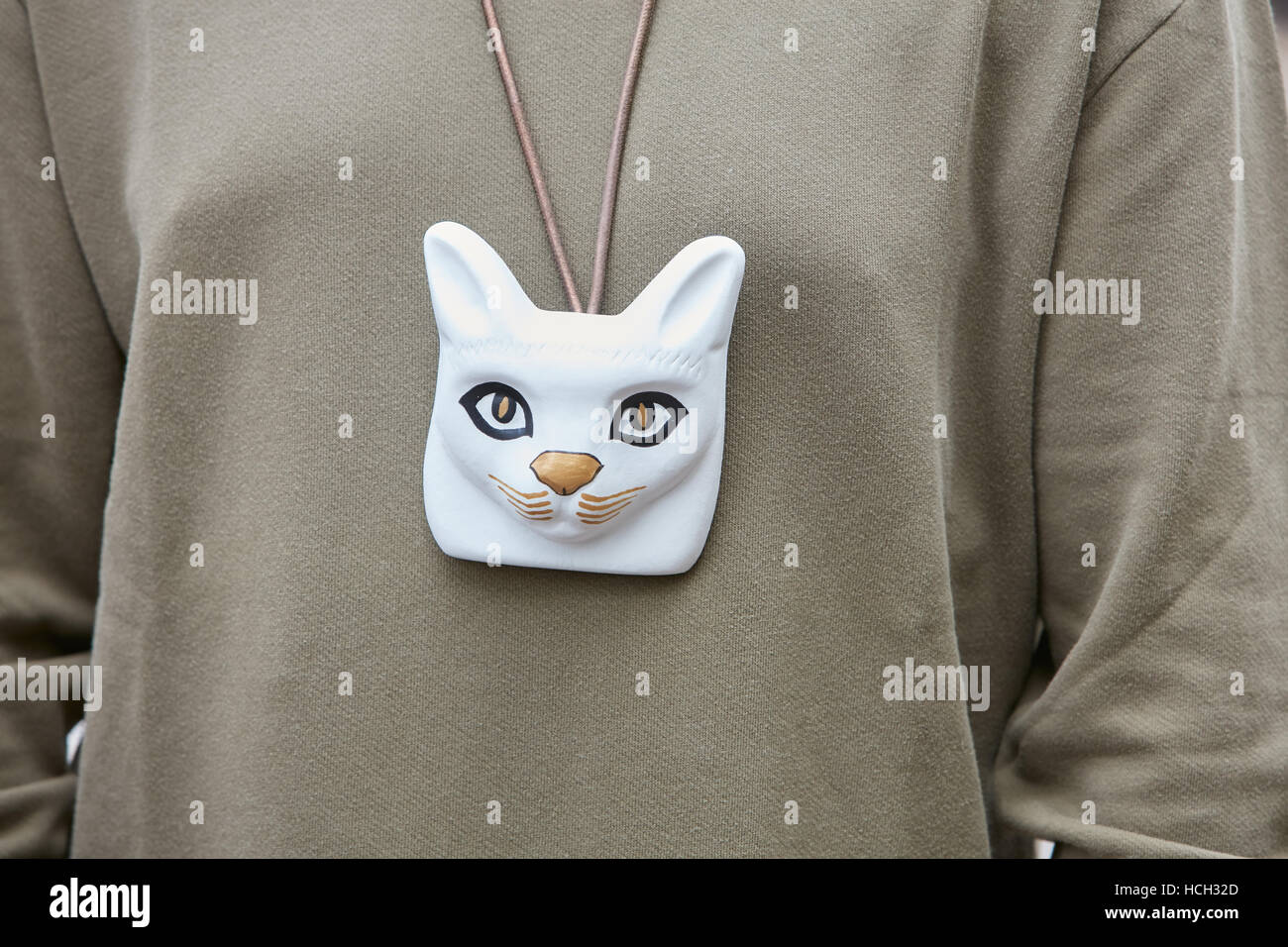 Woman with white cat head accessory before Cristiano Burani fashion show, Milan Fashion Week street style on September - Stock Image