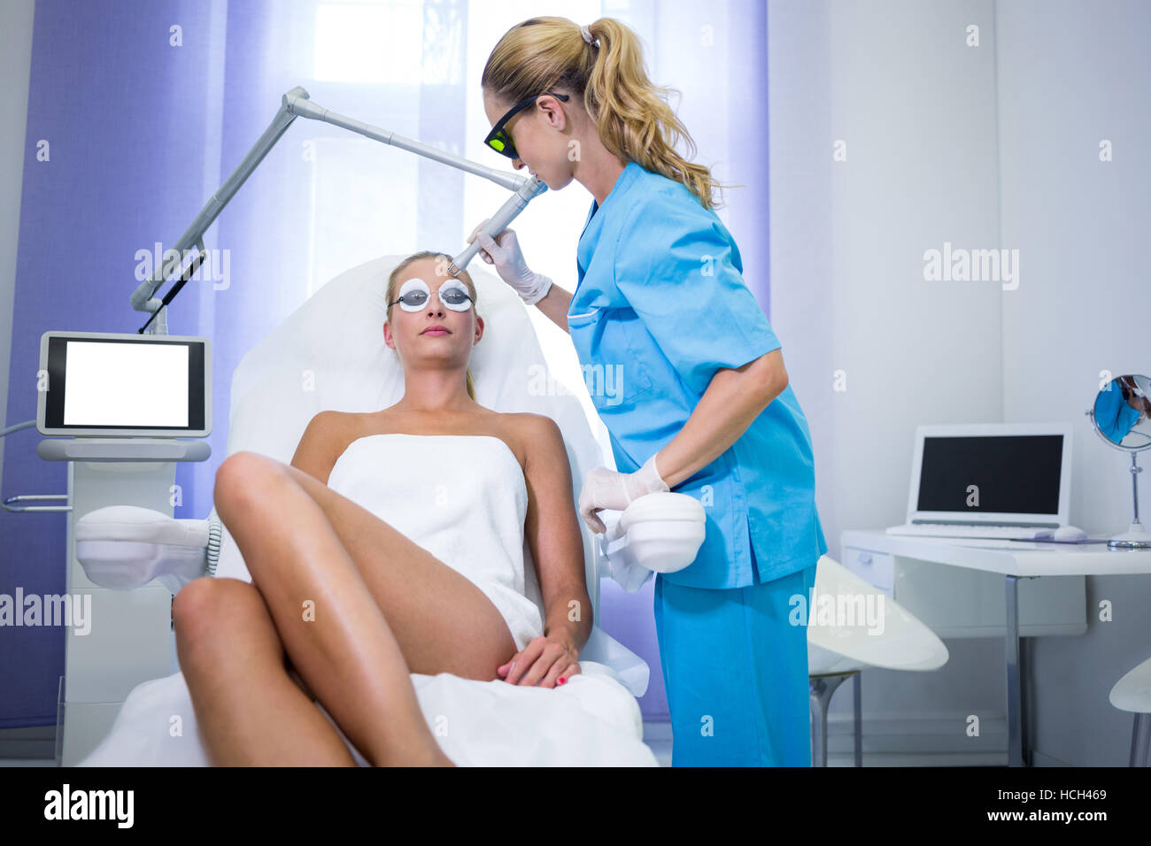 Female patient getting rf lifting procedure - Stock Image