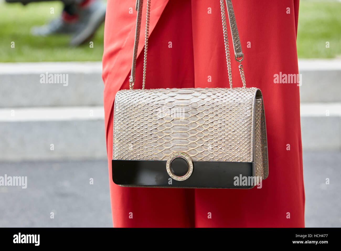 3729f6867ca Woman with Bulgari bag before Giorgio Armani fashion show, Milan Fashion  Week street style on September 23, 2016 in Milan.