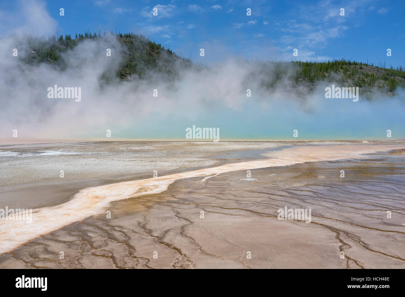 Teton County, Wyoming: Blue steam rising from Grand Prismatic Spring at Yellowstone National Park. - Stock Image