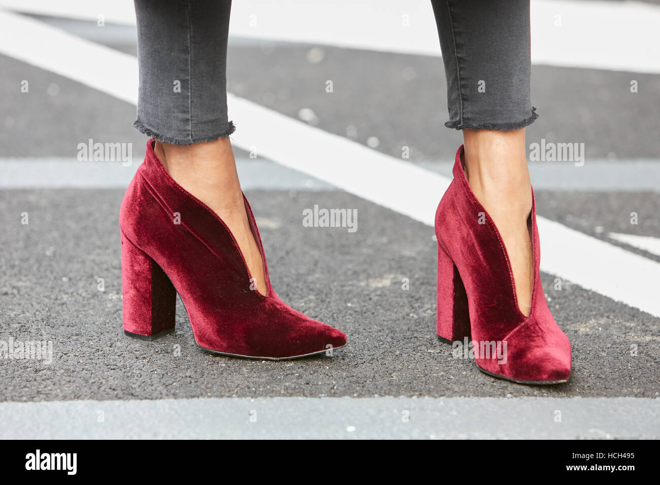 c2e6fb82291 Woman with red velvet high heel shoes before Giorgio Armani fashion show