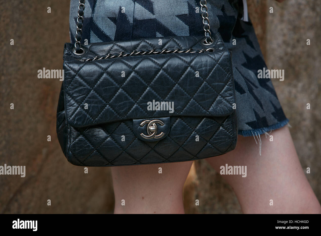 f14d7869383 Woman with black Chanel leather bag before Giorgio Armani fashion show,  Milan Fashion Week street style on September 23, 2016.