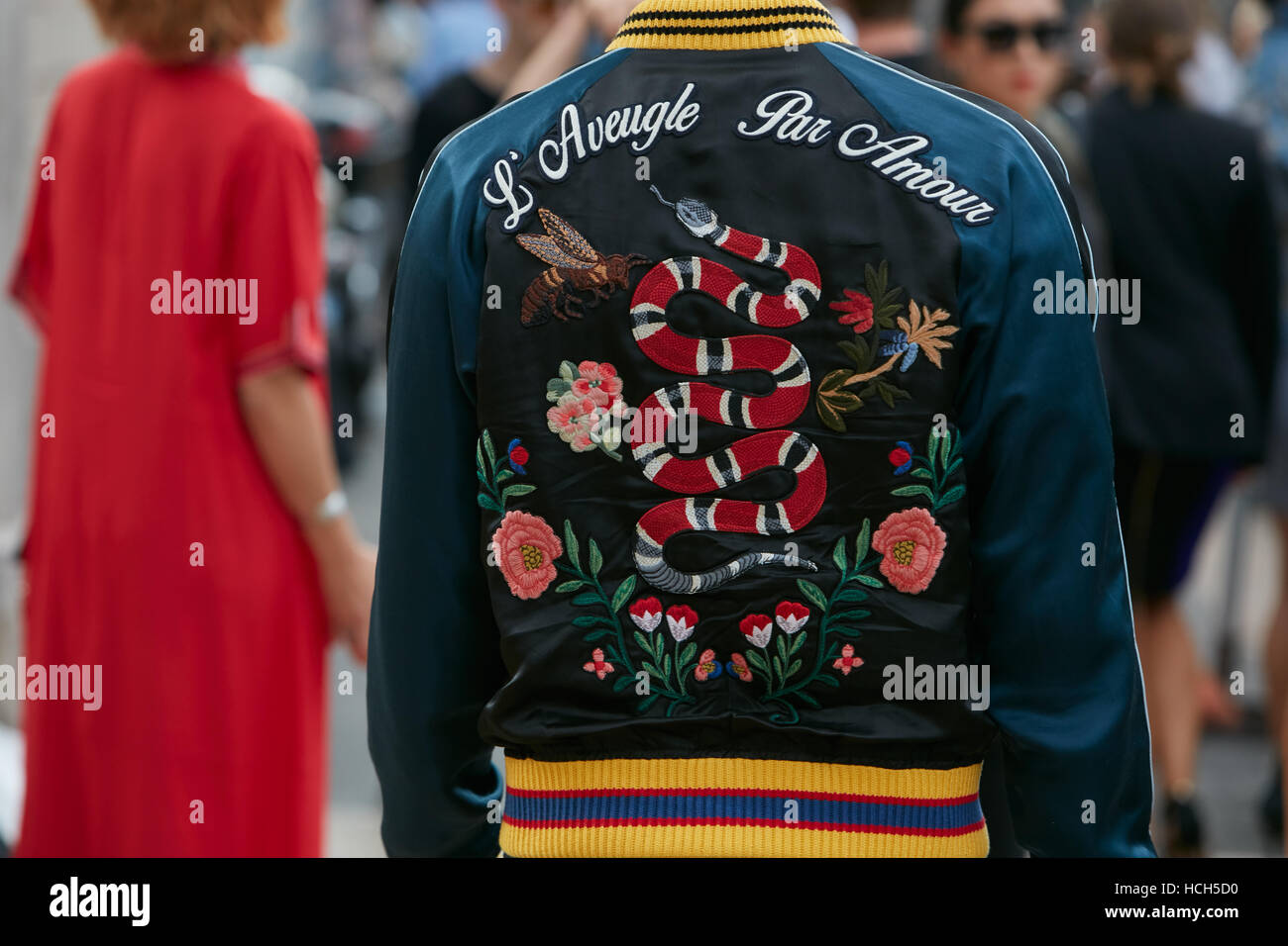Man with Gucci bomber jacket 'Blind by love' with snake and floral decoration before fashion Tod's show, - Stock Image
