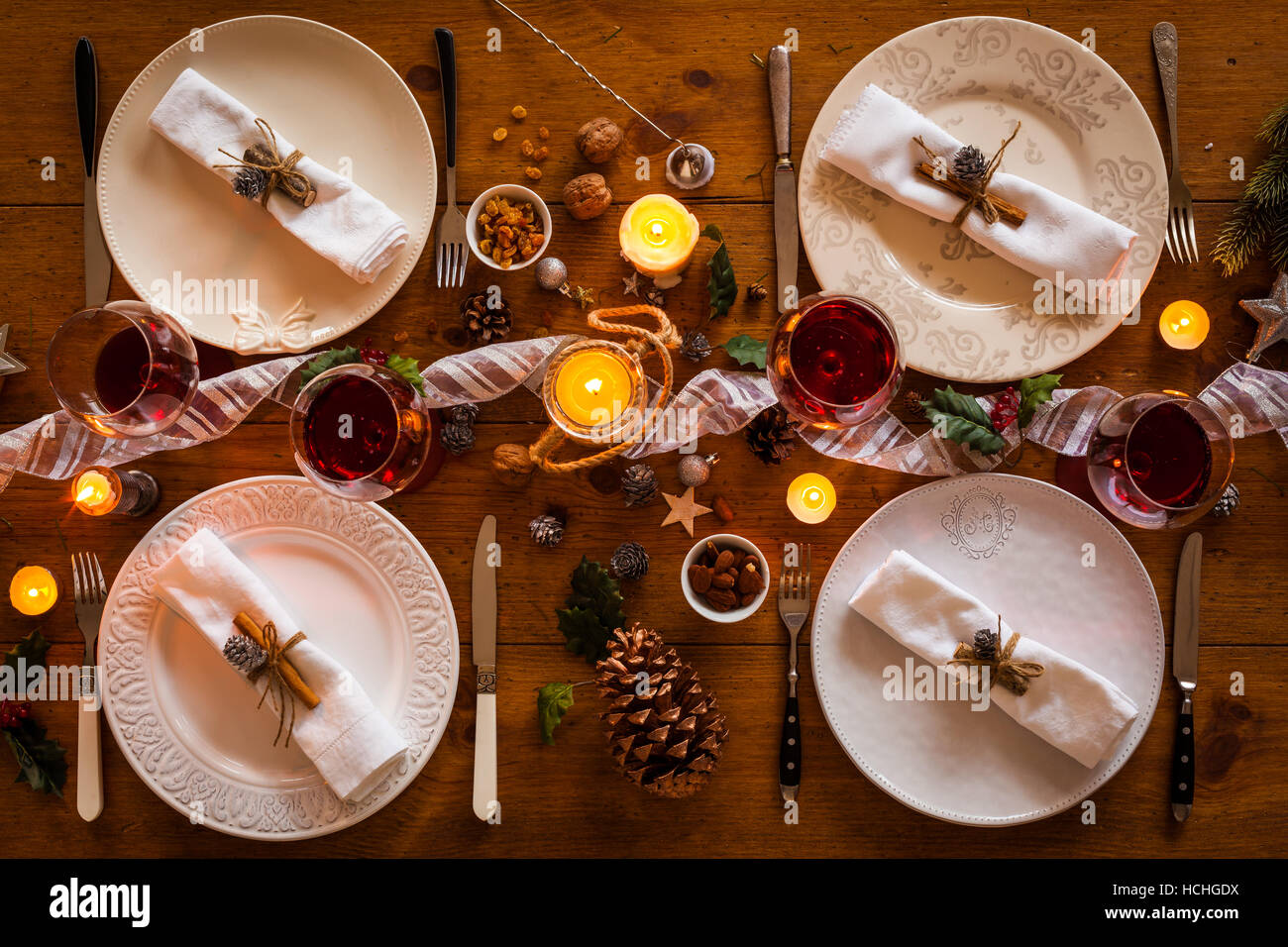 Christmas table setting for family dinner at a cosy rustic table with candles and decorations. Top view. & Christmas table setting for family dinner at a cosy rustic table ...