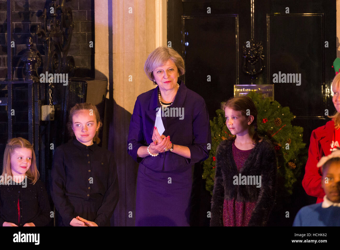 London, UK. 8th December, 2016. Theresa May the British Prime Minister with children nominated by UK charities and - Stock Image