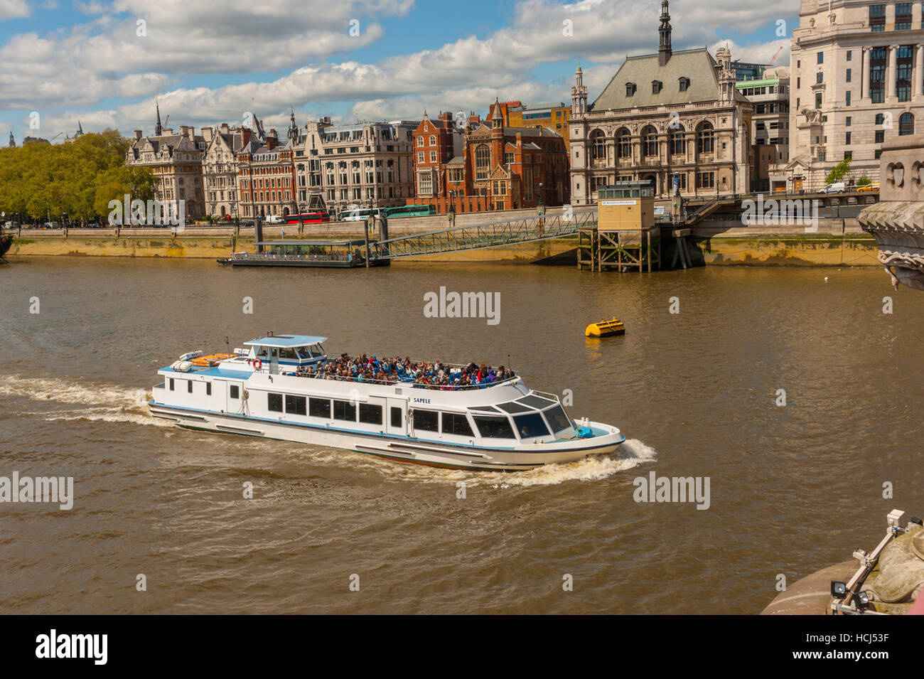 Tourist cruiser on the thames from blackfriars bridge. looking at the north bank thames. - Stock Image