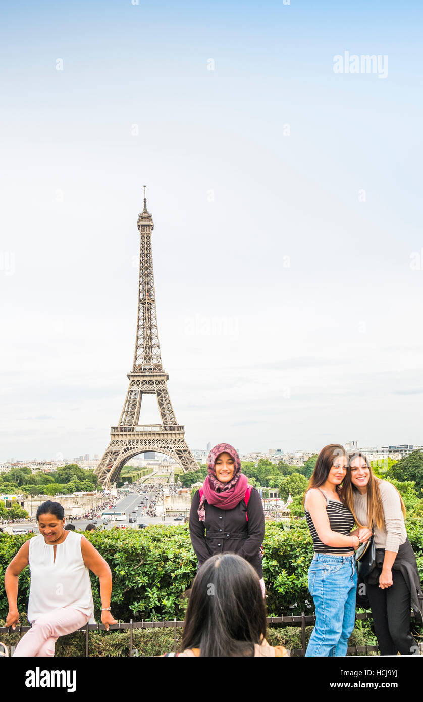 tourists taking photographs at  trocadero with eiffel tower as background - Stock Image