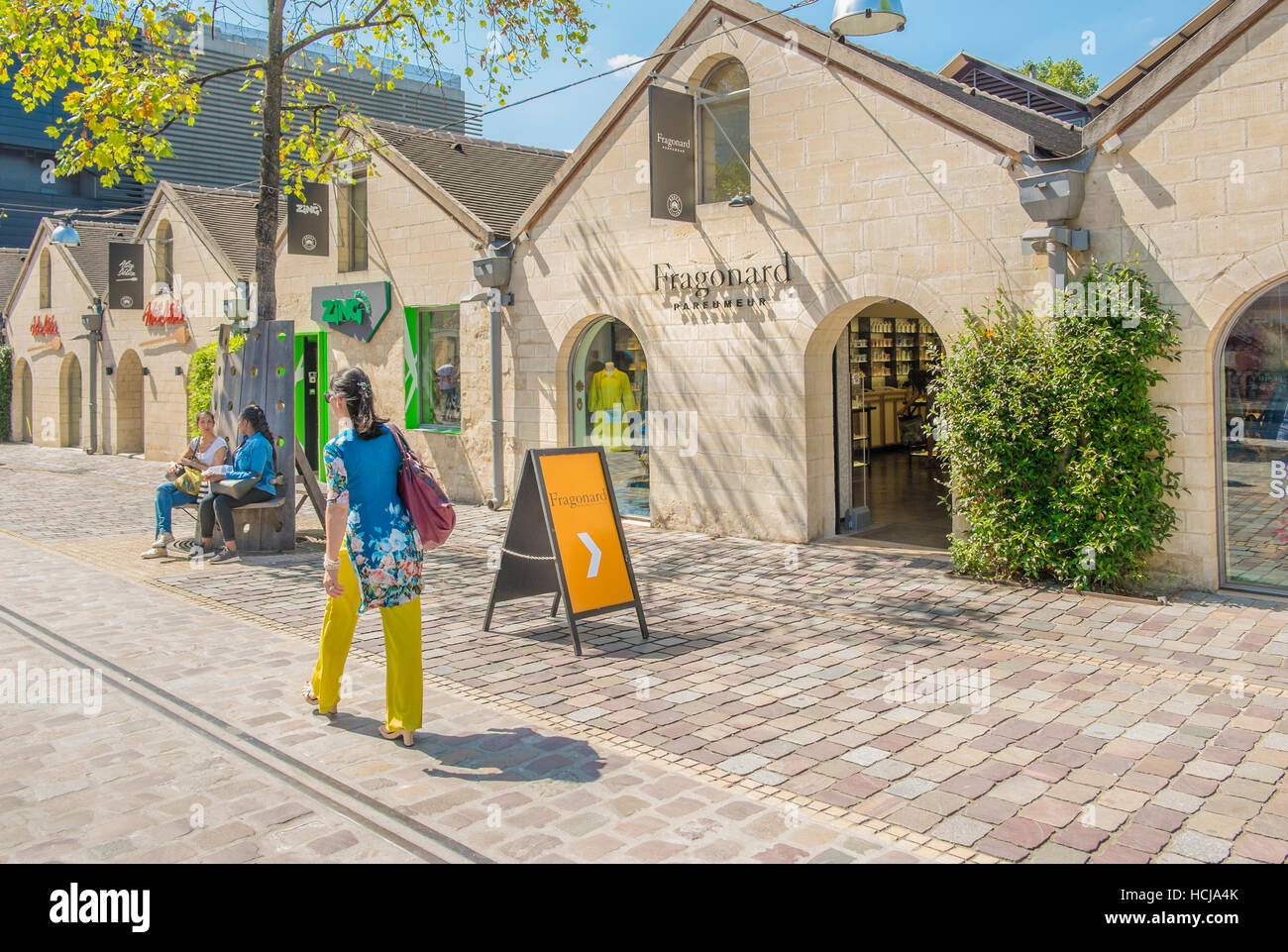 street scene in front of fragonard store bercy village outlet city - Stock Image