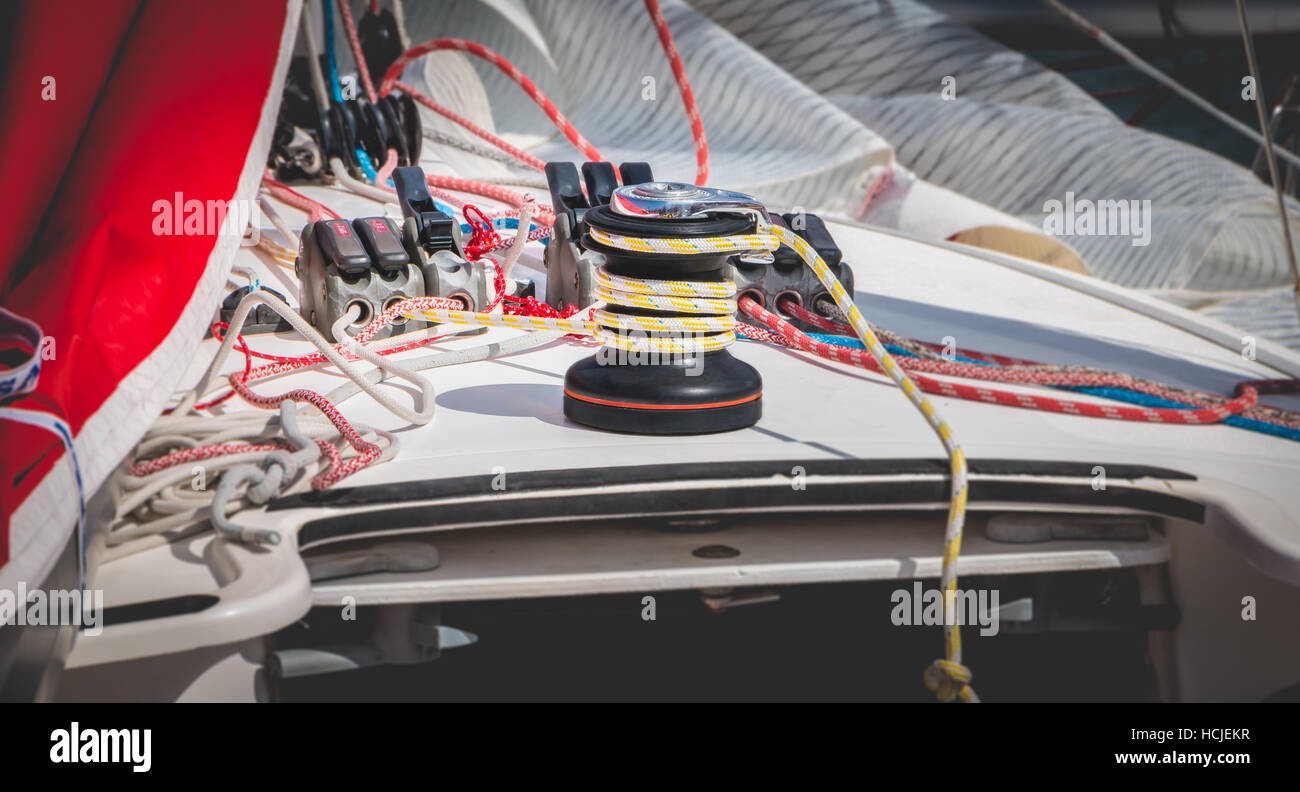 Sail boat winch with yellow rope close up - Stock Image