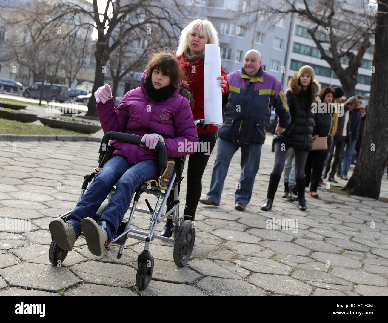 Sofia, Bulgaria - December 7, 2016: Physically and mentally disabled are accompanied by their parents, relatives - Stock Image